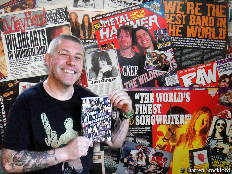 Gary Davidson, author of Zealot In Wonderland, with some Wildhearts press cuttings